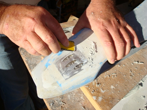 Bobby scrapping the filler around the lithoplate edge